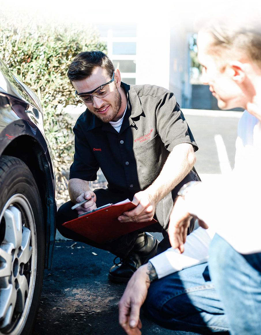 man checking tires